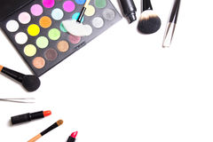 Make-up brushes, colorful eyeshadow palette, tweezers and lipsti Stock Image