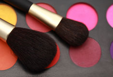 Make-up brushes and colors. Cosmetic brushes and makeup colors Stock Photo