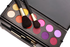 Make-up brushes and colors. Cosmetic brushes and makeup colors Royalty Free Stock Images