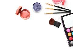 Make-up brushes and cosmetics isolated on white Stock Image