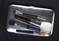 make-up brushes on dark background Royalty Free Stock Photography