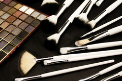 Make-up brushes in dark background Royalty Free Stock Images
