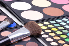 Make-up brushes on eyeshadows palettes Stock Photo