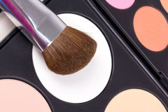 Make-up brushes on eyeshadows palettes Royalty Free Stock Photos