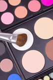 Make-up brushes on eyeshadows palettes Stock Images