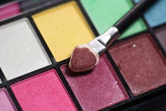 Make-up brushes on eyeshadows palettes Royalty Free Stock Photo