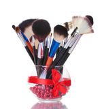 Make-up brushes in glass vase Royalty Free Stock Images