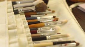 Various makeup brush set close-up.Makeup brush set. Make-up brushes in leather case. Various makeup brush set close-up. Makeup brush set stock video