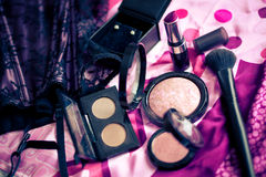 Make up brushes, lipstick and blush powder Stock Photos