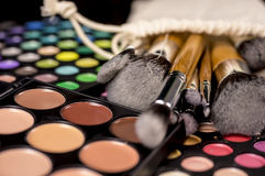 Make-up brushes  on makeup palettes Royalty Free Stock Images
