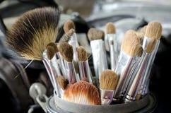 Make-up brushes. Old make-up brushes in holder Royalty Free Stock Photo