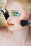 Make-up Brushes On Blond Woman Stock Image