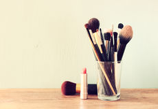 Make up brushes over wooden table Stock Photography