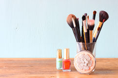Make up brushes over wooden table pic Stock Images