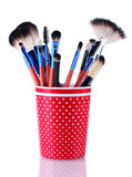 Make-up brushes in red cup Royalty Free Stock Image