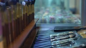 Make-up brushes on sale in beauty shop, professional visagiste tools, assortment stock video footage