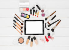 Make up , brushes and tablet computer on white background royalty free stock photos