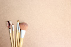 Make-up brushes on wooden background Stock Images