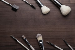 Make-up brushes on wooden background Royalty Free Stock Photo