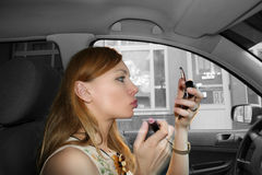 Make-up in the car Royalty Free Stock Photo