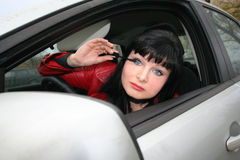 Make-up in the car Stock Images