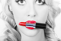 Make-up closeup. Cosmetic pinup girl in lip makeup Royalty Free Stock Photo