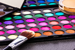 Make-up colorful eyeshadow palettes with makeup brush Royalty Free Stock Images