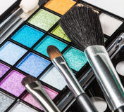 Make-up colorful eyeshadow palettes with makeup brushes Stock Photography
