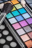 Make-up colorful eyeshadow palettes with makeup brushes Stock Photos