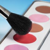 Make-up colors and brush Royalty Free Stock Photo