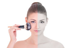 Make up concept - young beautiful woman applying rouge or powder Royalty Free Stock Photos