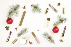 Make up cosmetic with Christmas decoration on white background flat lay stock image
