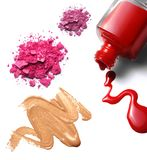Make-up cosmetics. Cosmetics: nail polish, foundation, crushed eye shadow. white background, isolated objects royalty free stock photography