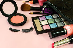 Make up with cosmetics and brushes isolated on pink background Royalty Free Stock Image