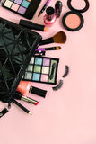 Make up with cosmetics and brushes  on pink background Stock Photography
