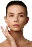 Make-up & cosmetics. Closeup portrait of beautiful woman model f. Make-up cosmetics. Closeup portrait of beautiful woman model face with clean skin on white stock photo