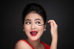 Make-up and cosmetics concept. Asian woman doing her makeup eyel Royalty Free Stock Photos