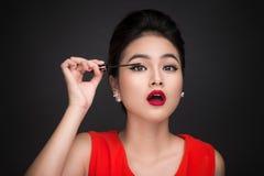 Make-up and cosmetics concept. Asian woman doing her makeup eyel Stock Photos