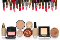 Make-up cosmetics set. Of liquid and cream foundations, compact and loose powder in various tones, bronzing pearls, blush and multicolored lipsticks isolated on Stock Image