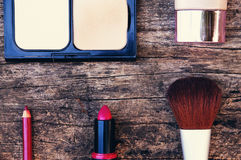 Make-up. Cosmetics such as lipstick or powder applied to the face, used to enhance or alter the appearance Royalty Free Stock Image