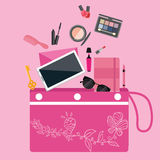 Make up cosmetics tools collection inside girls bag purse pouch pink color Stock Photos