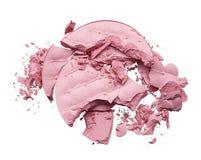 Make up crushed eyeshadow, blush or powder. Make up crushed pink eyeshadow, blush or powder on white background stock images