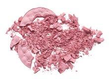 Make up crushed eyeshadow, blush or powder. Make up crushed pink eyeshadow, blush or powder on white background royalty free stock photos