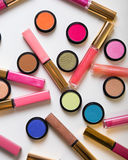 Make-up eye shadows with lip gloss. View from above. Flat lay Stock Images