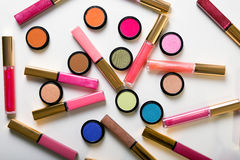 Make-up eye shadows with lip gloss. View from above. Flat lay Stock Photography
