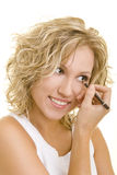 Make-Up with eyeliner. Blonde woman using eyeliner on her eyes royalty free stock images