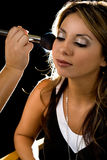 Make up face. Close up of a beautiful brown hair Hispanic woman having her make up applied stock image