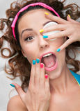 Make up fail or cosmetic allergy concept. Woman with cotton pad and colorolful nails Stock Photography