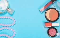 Make up woman essentials on blue background, Top view stock images