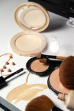 Make-up, foundation and brushes Stock Photos
